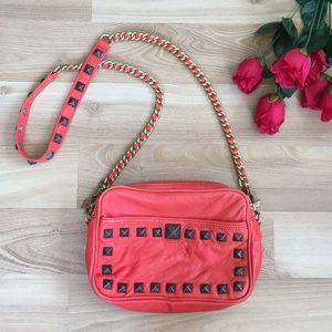 Rebecca Minkoff orange red studded shoulder bag.